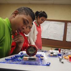 Youth using snap circuits