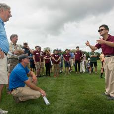 Turf Pathologist Dr. Geunhwa Jung talks to visitors about turf disease management research underway at the Center