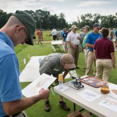 Visitors to the Joseph Troll Turf Research Center participate in an interactive display on techniques to improve turf establishment