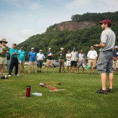 With Mt. Sugarloaf as a backdrop, Research Associate Jay Popko discusses turf pathology research at the Joseph Troll Turf Research Center