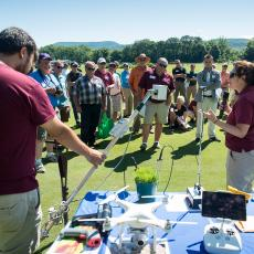 Dr. Michelle DaCosta, Turf Physiologist, and graduate student Jeff Lu demonstrate some of the equipment used in research at the Center