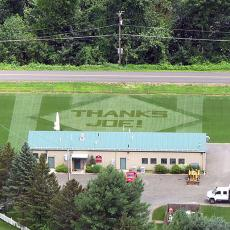 Aerial view of a lawn design reading 'THANKS JOE!' in honor of Dr. Joseph Troll, a longtime leader in the Turf Program at UMass and the Center's namesake