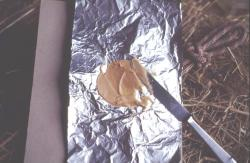 Making peanut butter bait with aluminum foil, Alan Eaton