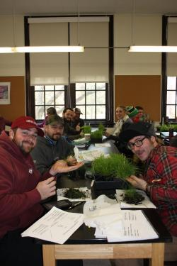 Winter School students participate in a grass ID lab.