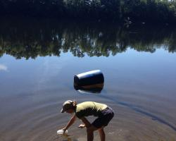 Research technician and Stockbridge undergraduate, Genevieve Higgins collecting water samples from the Connecticut River in Deerfield.