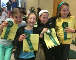 4-H members with ribbons