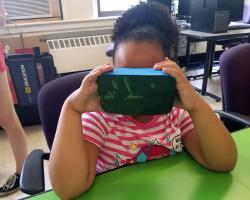 girl using virtual reality goggles