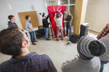 Students learn correct techniques for blower door tests