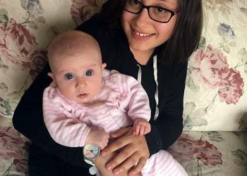 Ana Lois, 4-H member from Southwick babysits infant