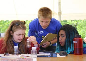 Students examine water at MA Envirothon