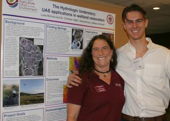Christine Hatch and Luke McInnis at CAFE  summer scholar poster session