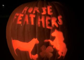 Horse Feathers Club won first prize for best spirit with 2 horses, a chicken, 4-H clover and their club name carved into their pumpkin!