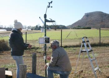 Elizabeth Garofalo and Jon Clements install watehr station at UMass Agronomy Farm in  South Deerfield