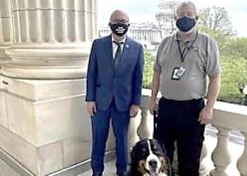Congressman Jim McGovern with George Brown and K9 dog Teddy