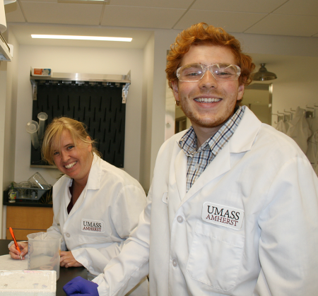 Professor Madelaine Bartlett and senior Jeffrey Heitmar in laboratory