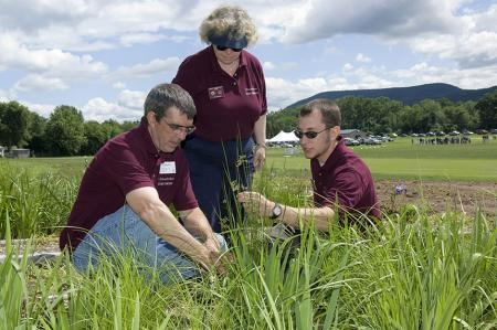 Extension's Mary Owen and Jason Lanier (center and right) review some of the latest research being conducted at the Joseph Troll Turf Research Center in South Deerfield with Jeffrey Doherty of the Department of Veterinary and Animal Sciences
