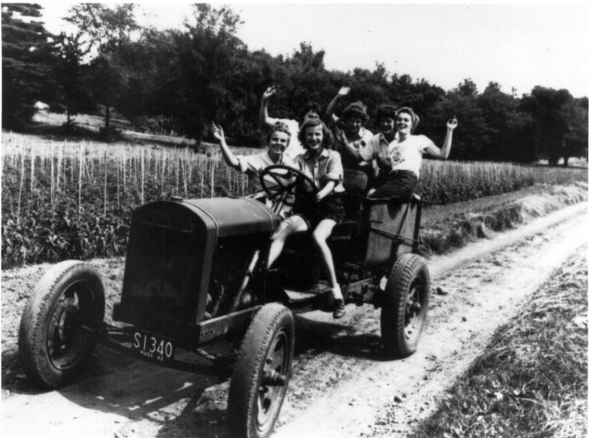 Women Students on Farm Vehicle