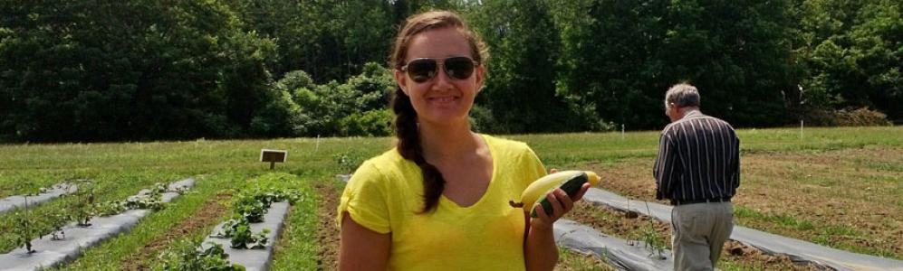 Cassie Sefton, Student Intern at ALC harvests summer crops