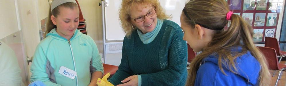 Judy Vollmer instructs students in use of age appropriate toys for young children