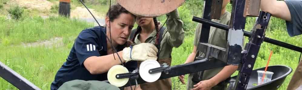 Christine Hatch assembles fiber-optic plow to cut through bog and lay fiber-optic cables Photo: Clarie Esterman