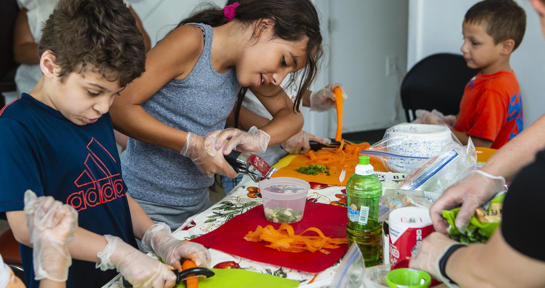 Children at Robinson Gardens in Springfield prepare healthy salads