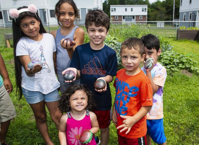 Children at Robinson Gardens show painted rocks to identify plants