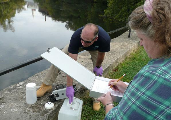 Beckie Finn of WRRC and Stephen of Narragansett Bay Commission sample the Blackstone River in Rhode Island