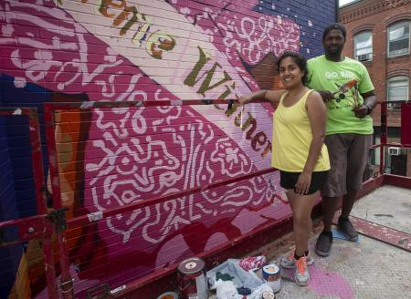 Artists Priya Nadkarni and Ahdrae Green paint mural on Taylor Street, Springfield