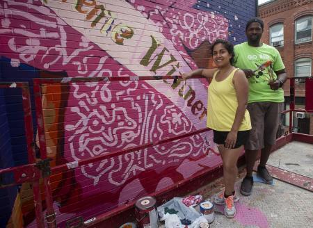 Artists Priya Nadkarni and Ahdrae Green paint mural on Taylor Street, Springfield