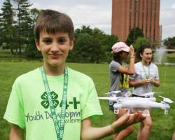 4-H camper holds drone