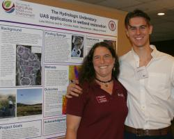Christine Hatch and Luke McInnis at CAFE  summer scholar poster session