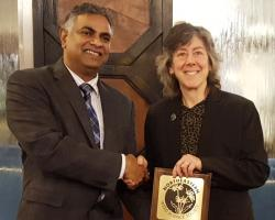 Dr. Rakesh Chandran, NEWSS Past-President presents award to Dr. Hilary Sandler