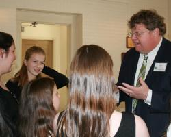 Board Chair Kent Lage talks wtih Plant-A-Smile 4H Newton Club