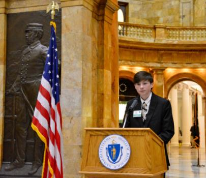 Trevor speaking at the State House