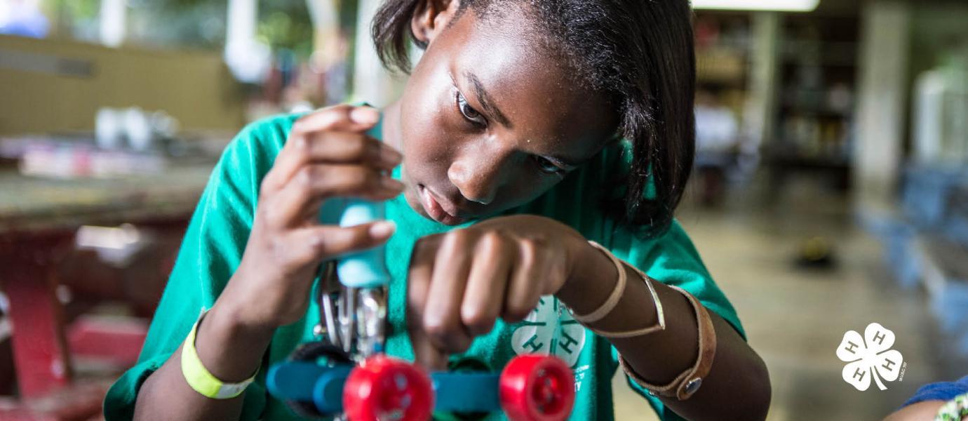 girl building robots