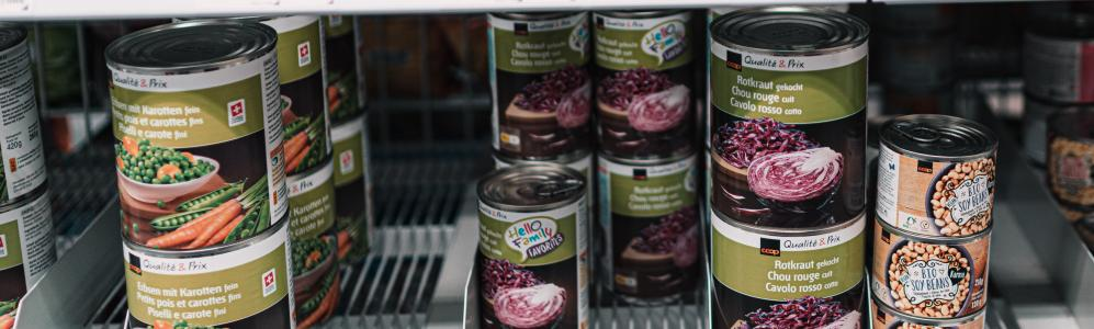 canned food on shelf by claudio schwarz on unsplash